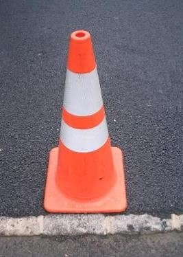 An orange and white traffic cone